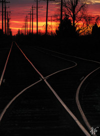 Photo: Train tracks at sunset